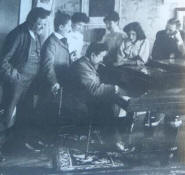 Albéniz playing piano for a group of friends